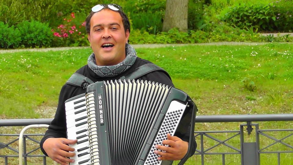 man singing with accordian