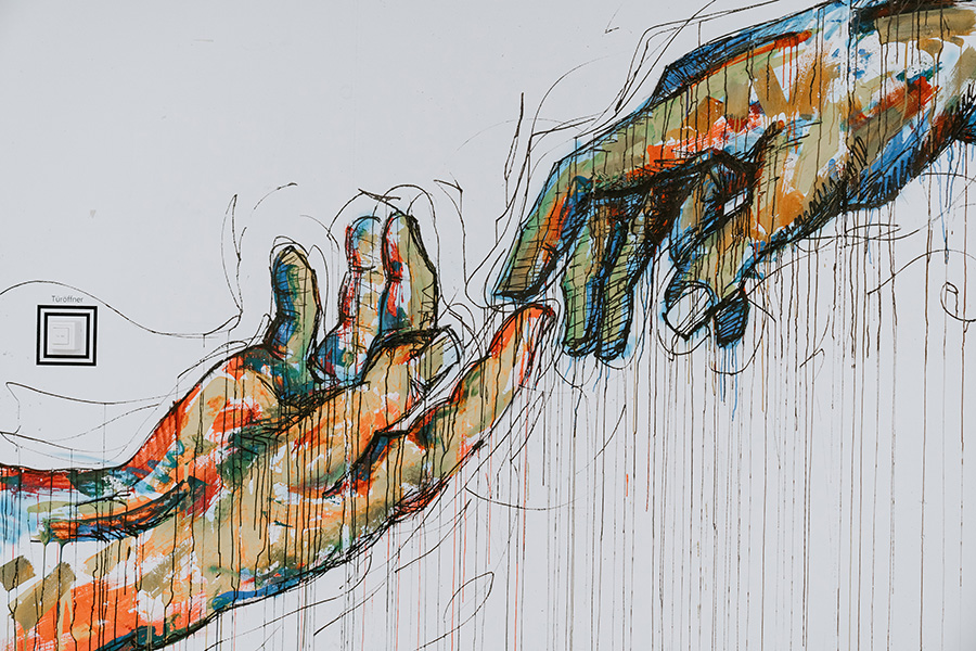 LinkedIn Profile. Showing a graffiti image of two hands reaching for connection.