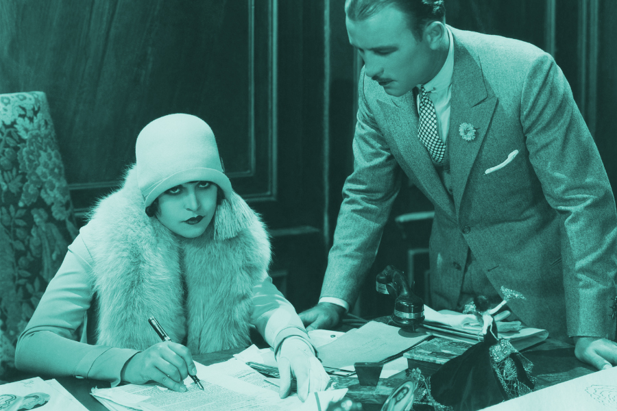 Managing Social Marketing image of a 1920s looking woman angrily signing a form while a man watches.