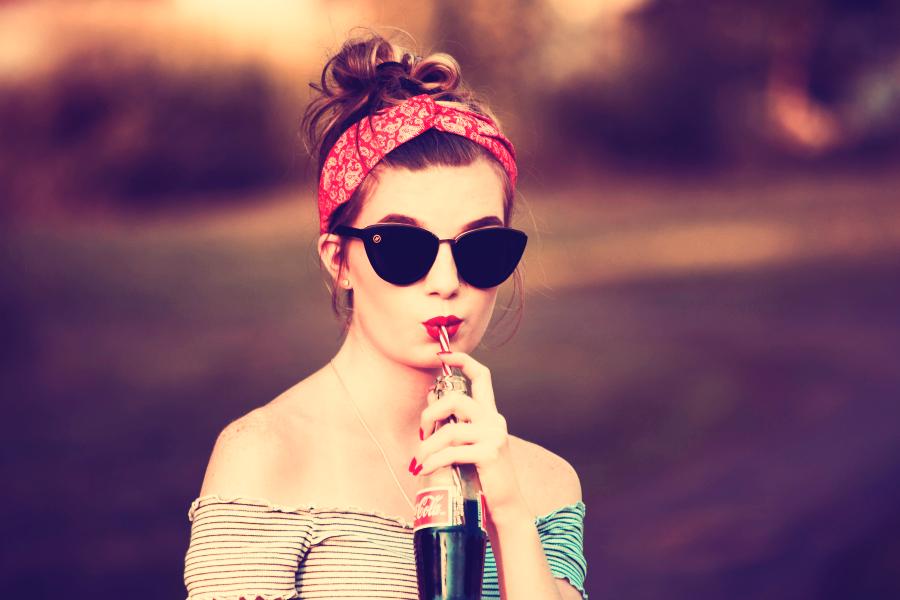 Innocent archetype. Vintage woman drinking a coke.