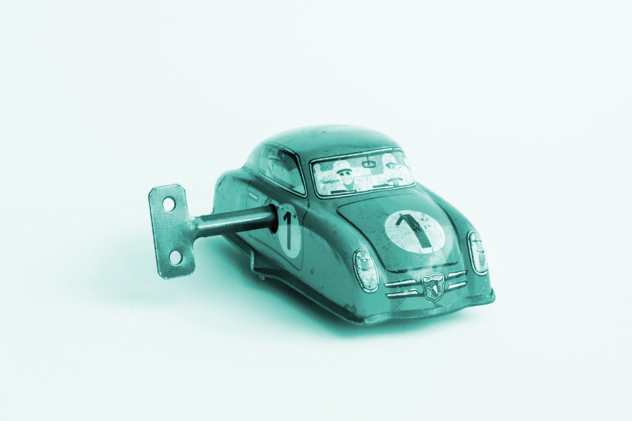 reusing content: shows a small metal wind up toy car.