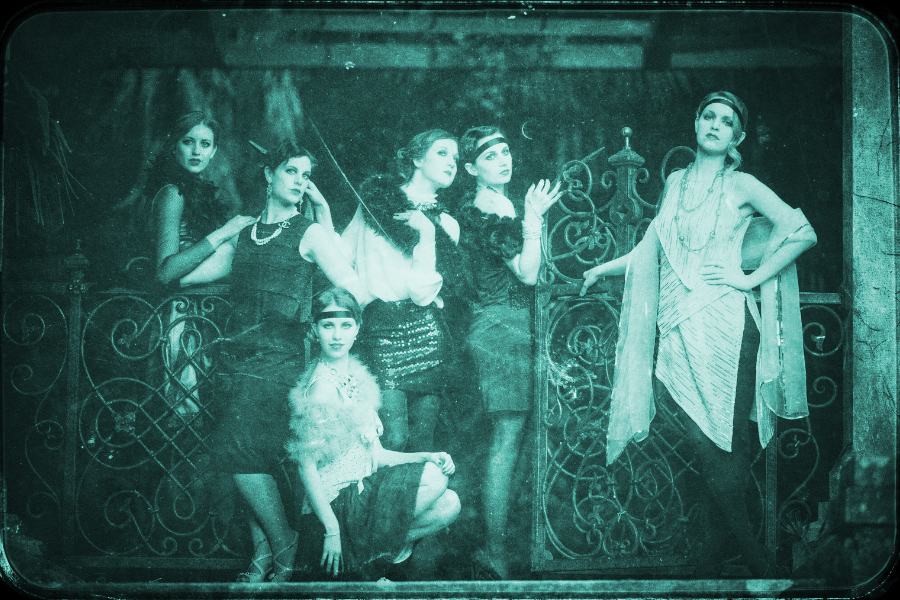 Promoting Your Community, showing women in twenties flapper clothes standing in front of a wrought iron fence.