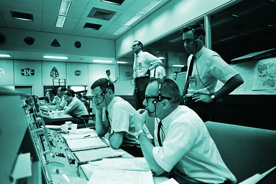 launch a new brand showing a vintage photo of NASA mission control